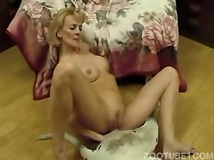 Fake-boobed blonde MILF rides a dog cock like a cowgirl