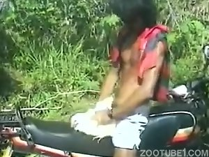 Toned zoophile in sunglasses bangs a white cock