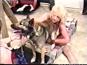 Mature strange women have sex with docile dogs